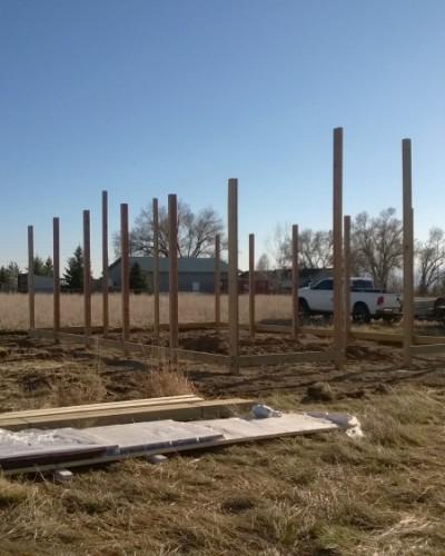 Pole building poles